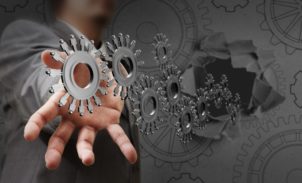 Image of man with gears coming out of hand